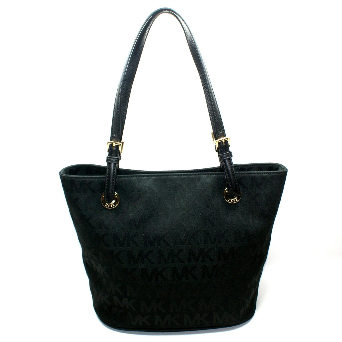 Michael Kors Black Jet Set Travel Medium Saffiano Leather Top-Zip Tote 30T5STVT2L Jet setters, take note: this sophisticated, multi-tasking tote is the ultimate travel accomplice. Crafted from Saffiano leather, it evokes a chic, away-we-go attitude.
