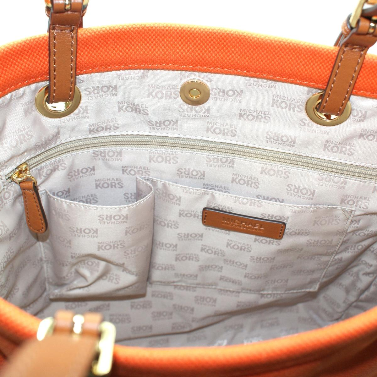 7b9cda23bfd181 ... discount code for home michael kors jet set tangerine canvas tote. click  thumbnail to zoom