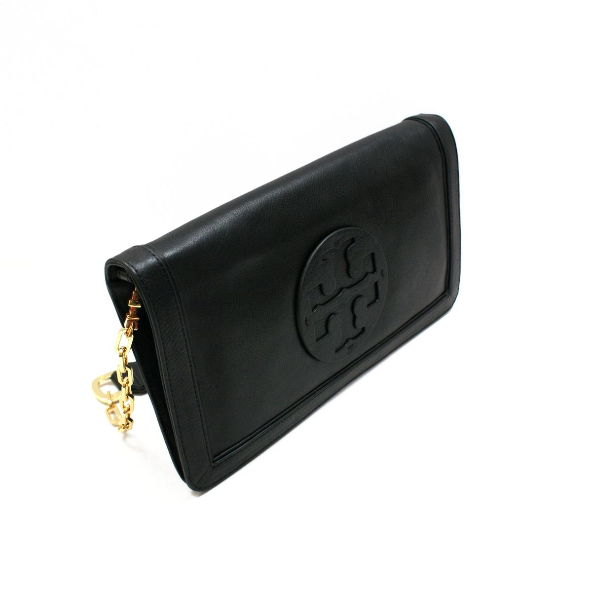 Leather clutch bag, Ipad case made of soft black distressed leather. It could be use as evening or everyday clutch and as Ipad case as well. The bag closes through metal ykk zipper and colorful bag charm is added as finishing touch.