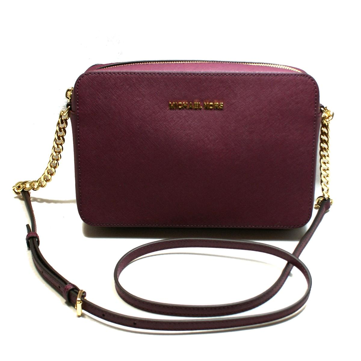 d9e682ab632f Home · Michael Kors · Jet Set Travel East/West Genuine Leather Crossbody Bag  Plum. CLICK THUMBNAIL TO ZOOM. Found ...