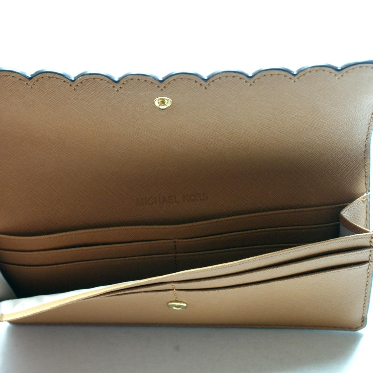 25cfe114c1b7 Home · Michael Kors · Desi Flat Leather Flap Wallet/ Clutch Acorn. CLICK  THUMBNAIL TO ZOOM. Found In: Handbags